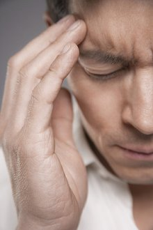 CONDITIONS TREATED. Library Image: Man with Headache